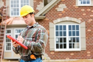 Home Inspector In Front Of House